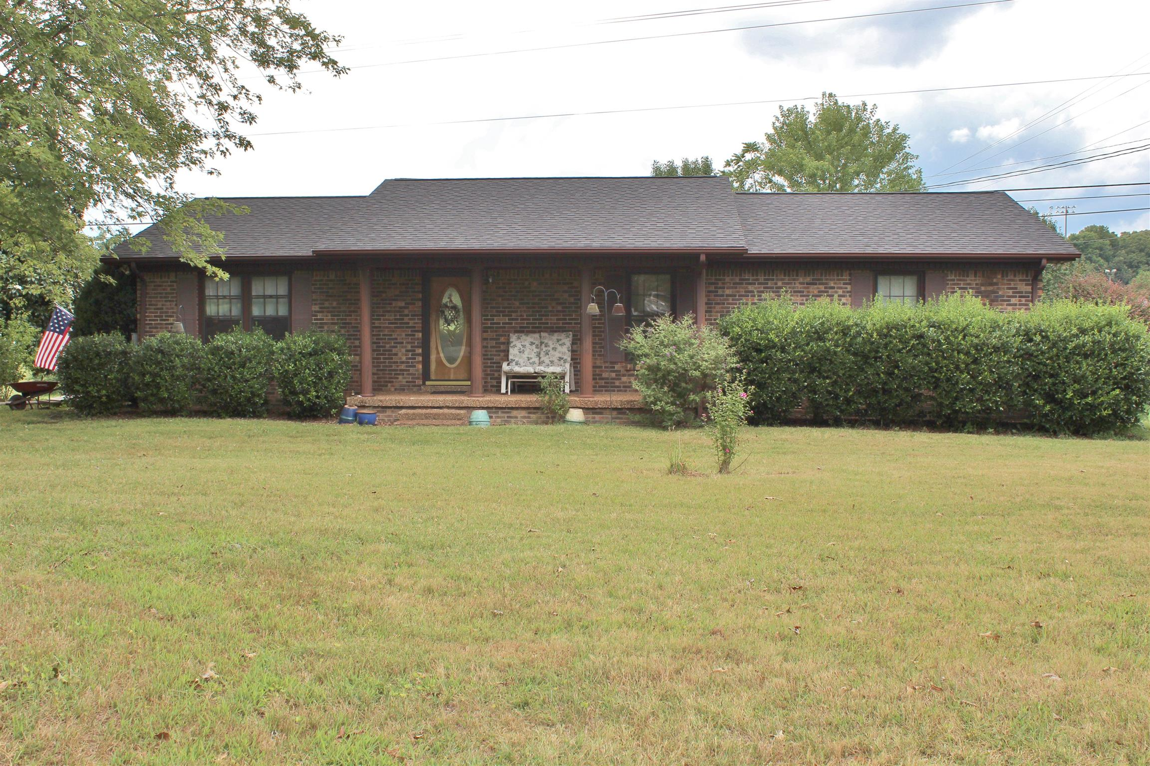 Nice well-built 1-level home on level acre. All brick, gas fireplace, oak kitchen cabinets, built-in bookcase, fenced-in backyard with lovely mature trees, huge storage building.  NEWER Roof & HVAC.  Convenient to schools; across street from Fairview Recreation Center. Renters in home; do not disturb.
