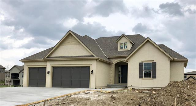 The Mockingbird plan BY:  Dan Smith Homes. 4 Bedrooms (Master suite & 2nd bedroom / office with private bath on the main floor.)  Island Kitchen w/ double ovens , pantry / desk / coffee bar area that is wonderful !  LARGE  dinning off kithcen  16 X 12.  Full walk out lower level w/ LARGE family room/ rec room, Bar, 2 bedrooms, 2.5 baths.  All the quality finishes you are looking to have !  must see.  Visit our New sales office at 15737 Chadwick -  WatersEdge-op.com to view available homes. Open 12-5 -Thurs.-Tuesday