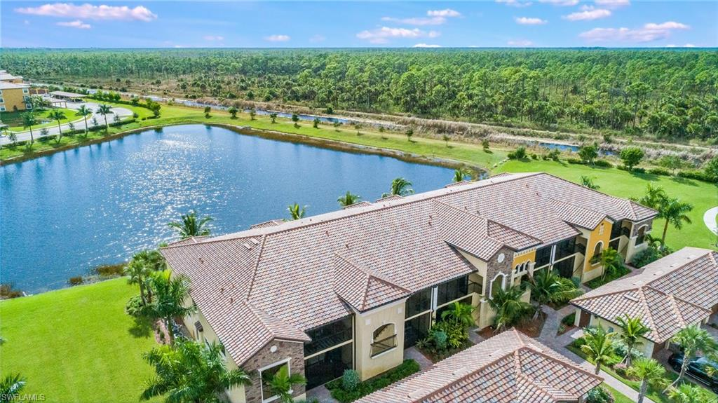 "NAPLES, FL – AVELLINO AT TREVISO BAY – Top Floor 2017 Veranda Home with spectacular SW views across the lake and preserve. The popular ""Bromelia"" Floor Plan offers 2 Bedrooms, Den, 2 Bathrooms, Living/Dining, Kitchen and Breakfast Bar, Breakfast Room, Dry Bar, In-Home Laundry and 1-Car Detached Garage.  Large screened patio at entrance and screened lanai to rear to sit out and enjoy reading, entertaining and watching the sunsets. The home is tastefully furnished with custom drapes and offered for sale in the British West Indies style with Lexington, Tommy Bahama Landara collection. Vaulted ceiling, Tile flooring, granite counters, crown molding, stainless steel appliances. Treviso Bay has two gates with patrolled security.  Amenities include two world class clubhouses for your enjoyment as well as resort pools, beach, tennis courts, bocce ball, basketball, gymnasium, beauty, bars, restaurants and walking trails. Social Membership is included with ownership of this home.  TPC/PGA Golf course usage available in the off-season. Avellino community offers its own pool, 8 x pickleball courts and BBQ area as well as sidewalks.  Contact Listing Agent to arrange Private Showing appointment."