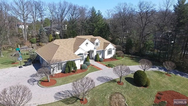 DREAM HOME ALERT! This spectacular ranch is sited on a  Spectacular 1.1 acre on east hill of Cresskill. Approx. 4,100 sq. ft of liv. Space + huge  fin. basement & 2 car garage. Prof. landscaping & pavers driveway accentuate the curb appeal. Enter the double doors to a 12' high foyer. Over sized windows flood the living & dining rooms w/natural light. Ideal for entertaining! Newer Pogen Pohl kitchen, great room fpl & vaulted ceiling plus sun drenched den. Overlooking the backyard the EIK has Sub Zero, Miele & Dacor appliances & a huge pantry. Convenient one flr living mbedrm/ fbth & WIC, En-suite + 2 addl bedrooms & large hall bath. A huge finished basement has a space for a 2,500 bottle wine cellar, a full bath, a bedroom, a huge rec room, a gym and, a home theater with a 7.1 surround system and 100' screen., large blue stone patio, BBQ, full house generator, sprinklers, new roof, Blue Ribbon schools,10 miles approx. to NYC. TAXES UNDER APPEAL!! OWNER HAS NYC REAL ESTATE LICENSE.