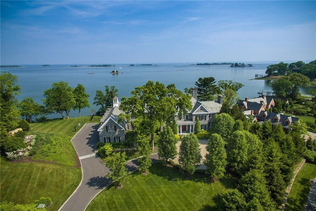 Elegant and timeless Georgian manor perched high across 2.88 acres of spectacular sweeping open waterfront on the Long Island Sound. This stately home is located in the sought after private association of Wilson Point. Artfully accented throughout are grand rooms that blend seamlessly with open casual family living. Included are luxury amenities any discerning buyer would seek: theatre, wine cellar/tasting room, gym, heated infinity pool, dock, cabana bath, four car garage and so much more. Added bonus: two story staff/guest quaters with kitchen and private entrance. The association includes private beach club, tennis, beach, playground and deep water dock.  Also for rent $30K monthly. Property Video: https://vimeo.com/188245700