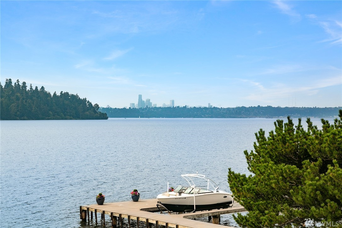 Exceptional gold coast waterfront on Mercer Island. Enjoy jaw-dropping Western views of the lake, Seattle skyline & Seward Park framed by soaring walls of windows. 125' of western low bank lakefront w/ private dock, level lawn & expansive entertaining deck. Completely updated, this 5BDR home boasts vaulted ceilings, a main floor master & perfect blend of formal & informal living spaces. Quiet & serene – set in an ideal mid-Island neighborhood w/ easy access. Your life on the lake awaits.