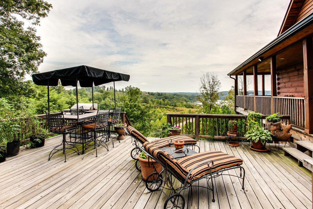 This luxurious log home sits on a hill overlooking Standing Rock Bay on KY Lake. Just 100 yards from the lake and the community dock. 5 minutes to Paris Landing Marina. This home has been built with quality and luxury in mind.  Incredible views of the Tennessee River and KY Lake from every room.   Lots 20 and 21 have been combined.  SHOWPLACE