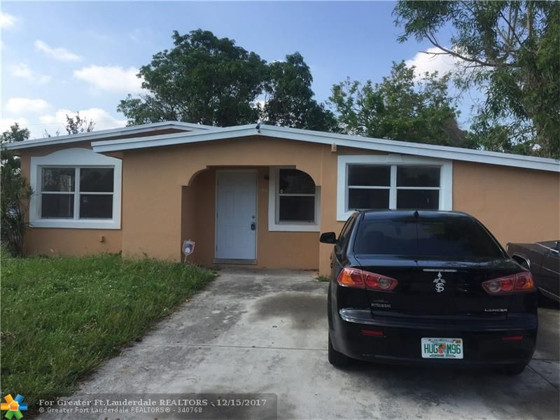 Charming 4 bed 2 bath on a quiet street in Lauderdale Manors! New roof installed in 2014! Spacious kitchen with real wood cabinetry and big island!. Beautifully remodeled bathrooms,  wood laminate floors in bedrooms and living room, tile in kitchen.  Huge mango tree in backyard that yields big juicy mangos during the summer!