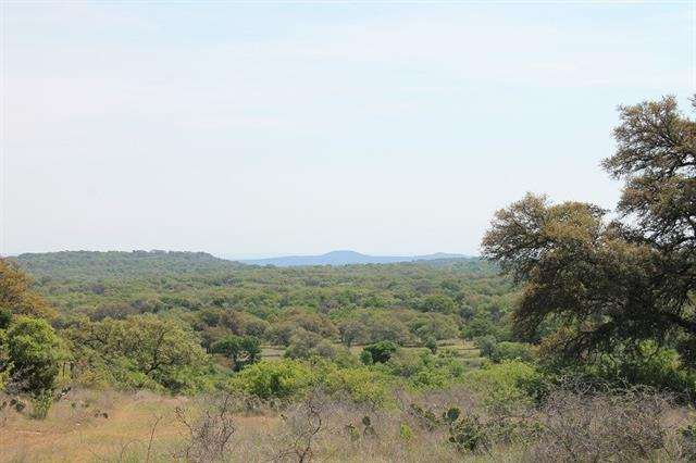 This ranch is located in the heart of whitetail deer country just south of Llano. Unbelievable views of Enchanted Rock & the surrounding Hill Country. A wet weather creek bisects the ranch creating beautiful rolling landscape throughout. Abundant oaks & other assorted hardwoods provide excellent cover for wild game. Fenced & has a water well. Located on CR 312  15 minutes from Llano & 1 1/2hrs from Austin. Buyer's agent must be identified on first contact & must accompany buyer on first showing.