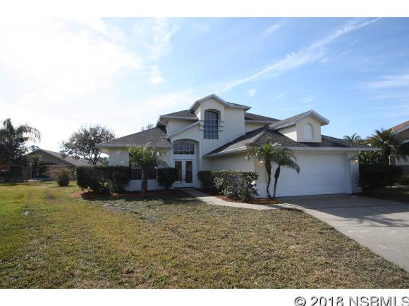 Beautiful 3/2/1 masonry home in upscale Cypress Head.  Walk to first tee/clubhouse, tennis courts, and community pool, yet on a quite cul-de-sac. Super convenient to shopping, the beaches, and Spruce Creek. Excellent school district. Brand new roof, new paint inside and out, new carpet, new upgraded Samsung appliances, 17 foot ceilings with crown moulding, LED lighting and a large back yard for pool or pets. Must see this move in ready home!