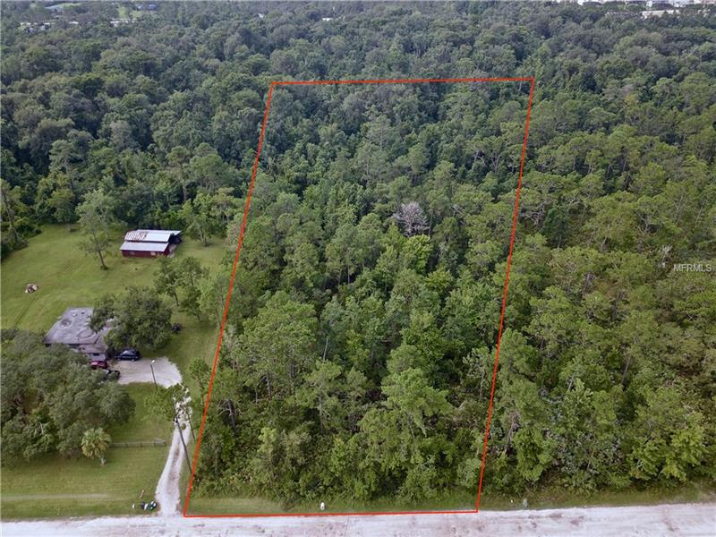 Come build your custom home with this rare opportunity to own 5+ acres in Oviedo off Old Lockwood Rd! Country living in the city, this lot is close to everything that Oviedo has to offer while maintaining the privacy you won't find anywhere else. New communities' homes on either side of Red Ember Rd are selling for $500-$600,000+ on small lots with high HOA fees. With a historically low number of houses on the market you could build your CUSTOM, DREAM HOME in the amount of time it takes to find a house you're settling for- with no HOA! This private area is home to close-knit neighbors who watch out for each other, while giving you ample space so you will never have to see them. Conceptual site plan showing wetland, septic, driveway, and building setbacks has already been completed. Plenty of space to build! Oviedo is located in Seminole County, home to some of the top rated schools in Florida. Hagerty High School is a short walk down the street, while community amenities like the brand new Oviedo on the Park are just minutes away. Twin Rivers Golf Club, UCF, and quick access to the 417 are within a few miles! Check out the video link in the Realtor Remarks for aerial and drone footage of the location.  Contact us for builder recommendations as well, site plans available!