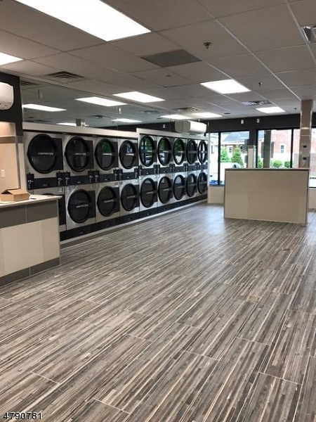 Prime location to own this brand new,  state of the art Laundromat. Equipment includes 14 Continental washing machines in three sizes, 9 continental dryers in two sizes, laundry carts, tables with shelves, chairs, TV, vending machines, wash and fold service area, wifi hooked up, free parking.   Located in 2 year old building.   Laundromat owner also owns building and will negotiate long term lease.