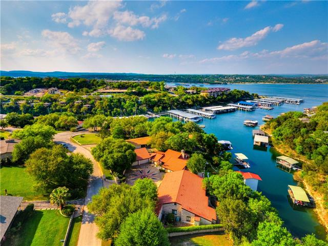 Bermuda on Lake Travis is a spectacular 1 acre waterfront estate! This captivating property is ideally located in a deep water cove that provides protection and a calming energy without sacrificing VIEWS or convenience. The main house offers an opulent master suite and awe-inspiring lower level with executive office and game room. 5 additional private suites provide luxurious accommodations. Huge boat/party dock can house up to 4 boats. A lifestyle to welcome family and friends for generations!