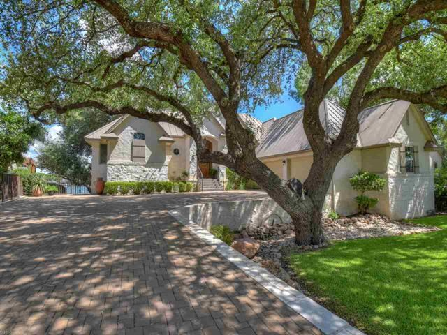 Custom waterfront home surrounded by 150+ year old live oak trees on 110' of east facing open water. Absolutely one of the most spectacular waterfront settings on Lake LBJ. Picture windows along rear, absorbing all the views of Lake LBJ & beautiful backyard. Main level includes family room, dining area, breakfast bar, gourmet kitchen, study (or optional 4th bedroom), powder room & master bedroom suite w/lakeside balcony. For guests & family, downstairs to private family room, wet bar & 2 bedrooms/baths.