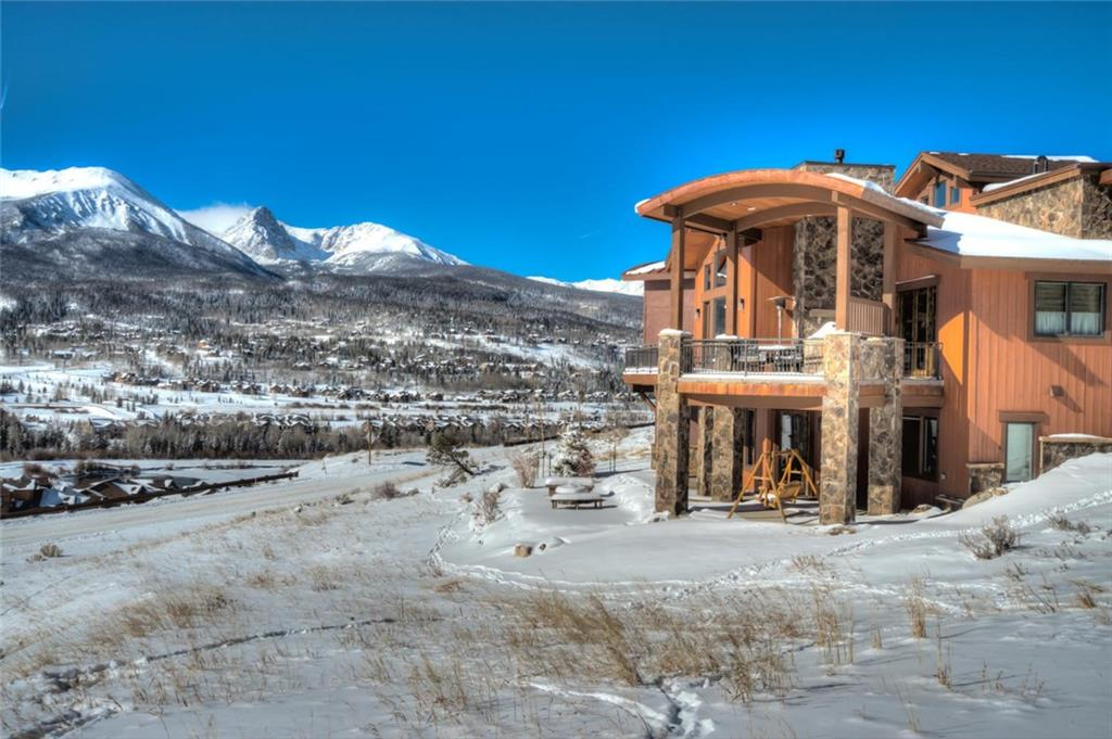 The WOW FACTOR! Have morning coffee in the sun room w/glorious views of jagged peaks & shining lake. This luxury home strikes a welcoming balance of modern finishes & unique architectural features while creating warmth w/ handsome masonry & natural woods. Gourmet kitchen. Sunlight galore through huge windows.  Dine at your fire ring or on the large deck with built-in BBQ. VIEWS!! Private lake-fish, canoe, paddle board & Hiking trails. Bath total is 3full/2half. See photo & drone tours.