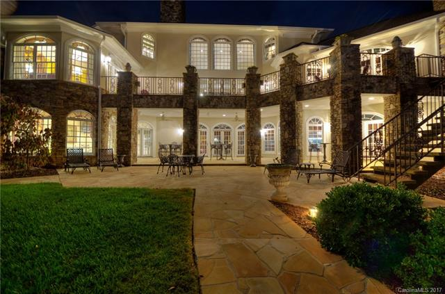 This exquisite French Country waterfront/private pier estate overlooks the 14th green of the top-rated Old North State Club & sits behind the private gates of the prestigious Uwharrie Point peninsula on Badin Lake.  The media room, bar, billiard room, spa & sauna make this perfect for entertaining after a day of golf or lake sports.  The custom walnut floors, woodwork, & cabinetry, marble bathrooms, and opulent draperies make this one of the most significant homes in the Uwharrie Lakes Region.