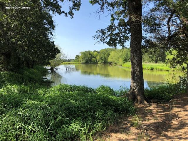 Tract 4 is 20+/- acres with a large tank and Sandy Creek, a wet weather creek. Pastures have improved grass. Also available is Tract 3  21.7+/- ac with a small tank, Sandy Creek and improved grass pastures. Tract 5 is 20.8+/- ac & Tract 6 is 20.9 ac, both have Sandy Creek and improved grass pastures. Perfect place to build your ranch home, run cattle, hunt, fish and even income from hay. All tracts offer paved road frontage with electrical and public water available at the road. Very mild restrictions.