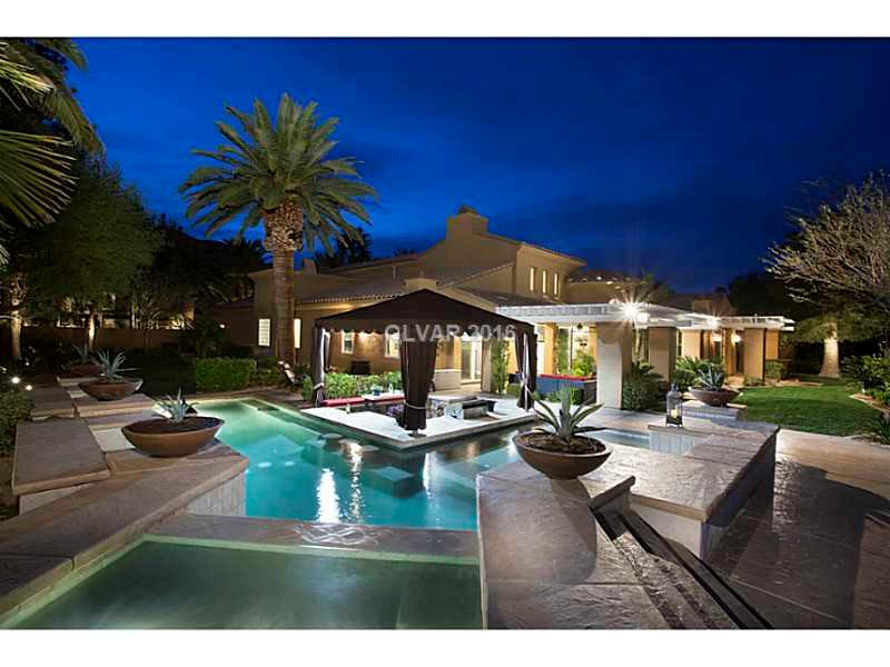 5109SF, 5 Bed, 6 Bath, 3 Car, 0.4 Acres, Stunning Tuscan-Style Semi-Custom. Spectacular Golf, Mountain and City Views, Fine Finishes. Stainless Steel Viking Appliances. Courtyard. 2 Fireplaces. Resort Pool & Spa. Sunken BBQ w/ Swim-Up Bar. Gorgeous Landscape & Palms. Lives like 1 story. All beds down. 2nd Level Retreat w/ Wet Bar & Juliette Balcony. Guard Gated Country Club Community. Entertainer Paradise. Welcome Home.