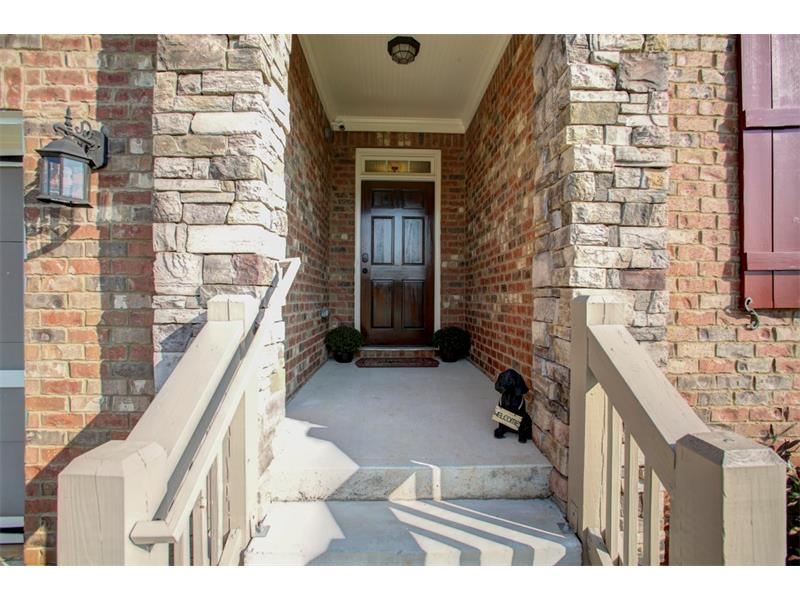 Welcome Home! This beautiful stone & brick home is truly stunning, inside & out!