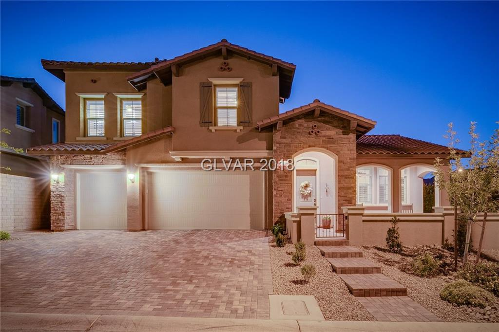 Stunning Summerlin home w/360 degree views from rooftop deck. Upgraded chef's kitchen, dual stacking glass doors from dining room & family room lead to secluded outdoor living space w/built in fireplace, covered paver patio, designer built-in BBQ, & synthetic lawn. One bed, one full bath down. Two bed plus large master w/en suite bath & custom walk-in closet upstairs. Wood-like tile in main living spaces, carpeted bedrooms with upgraded padding.