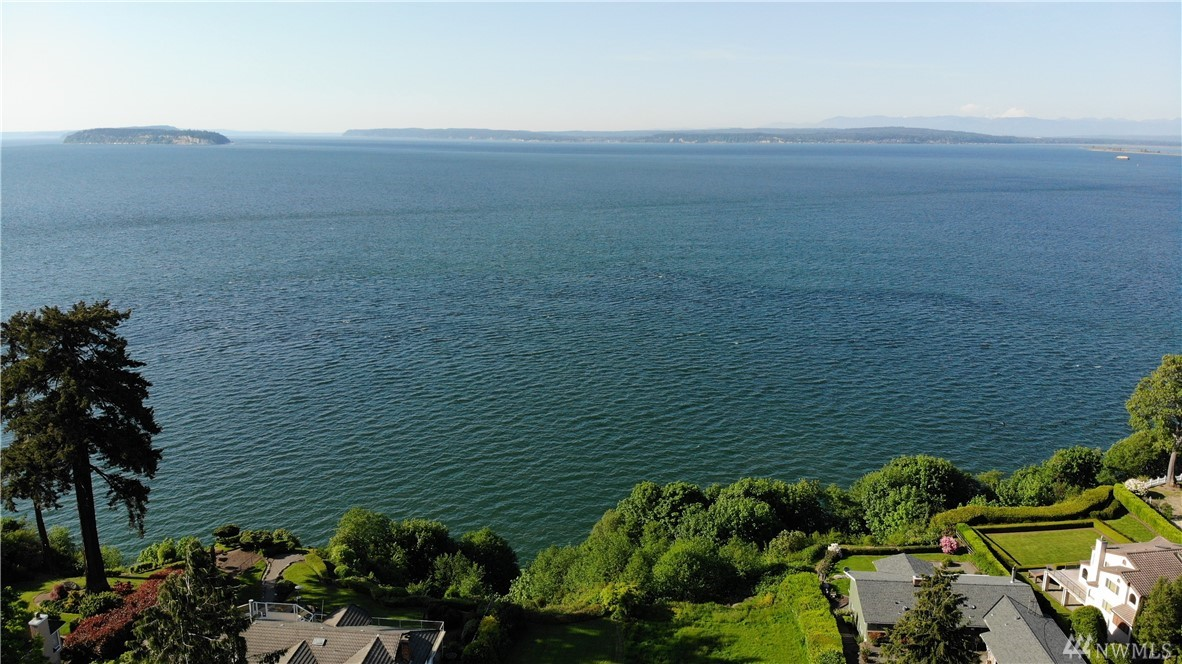 Amazing .49 acre high bluff view lot, Full Puget Sound view, Islands, Marina, Sunsets...  level, well drained, Power, Water, Sewer in place.  Surrounded by multi-million dollar homes.  Mukilteo schools - Kamiak High.  Minutes from Mukilteo, Everett, I-5.  Close to Ferry, Sounder, Parks and shopping.  The house is in disrepair, but safe to walk through with caution.  Motivated seller. Selling as is.