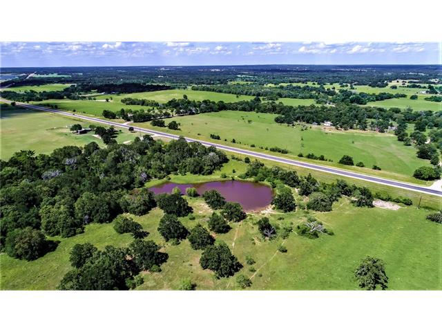 CENTRALLY LOCATED between Dallas/San Antonio/Houston - this property is a wonderful find. Nice mix of WOODS and open PASTURE. There are multiple PONDS, rolling terrain with nice HILLTOP, winding wooded TRAILS, and great VIEWS to be seen around every corner. Access is superb - great visibility from Hwy 77 for main entrance with frontage for side entrance off CR313. Great for RECREATIONAL or livestock use until you are ready to build! This combination of location, access and land features is a rare find!
