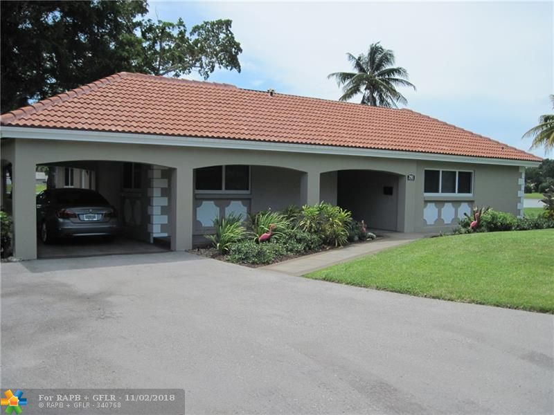 Stunning & completely renovated single family home/villa with a large panoramic lake view & bonus room. The WOW factor is truly here in this contemporary remodel including LED recessed lighting (on dimmers), NEW tile roof, hurricane impact doors & windows, kitchen (with a lake view) features new cabinetry w/soft close doors, high end SS appliances & quartz counters. Two spacious bedrooms both with large walk-in closets and ensuite baths w/high end fixtures. (master closet has custom built ins). The master shower is HUGE measuring approx 7x5 with a floor to ceiling glass enclosure. Relax & entertain on the huge patio which overlooks the beautiful lake & is pre-wired for a hot tub. The electric has been updated with a new panel inside and outside, absolutely nothing has been overlooked.
