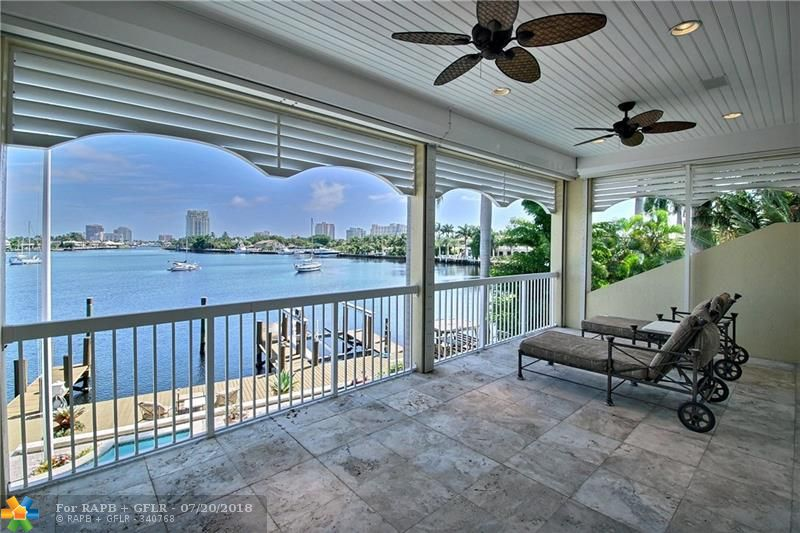 One of the most breathtaking wide water views in South Florida! 142' of deep water frontage w/quick & easy ocean access. Exceptional marina-like dockage with dolphin pilings which are grandfathered in. Beautiful open kitchen w/butler's pantry. Sophisticated mahogany library w/built-in bar & gas fireplace. Amazing master suite w/gas fireplace, huge walk-in closet, marble bath/spa and covered balcony. Fantastic gated Harbor Beach location, private beach & marina memberships available.