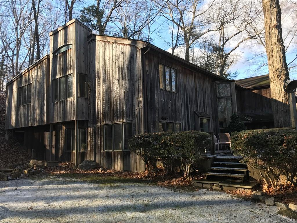 Great location!     Cul de sac in South Wilton.   Commercial kitchen.    This home needs some TLC, and has acreage in Norwalk and in Wilton.    In the winter you can see the pond down the street through the trees.    Lovely contemporary home.    Third party approval needed to close.
