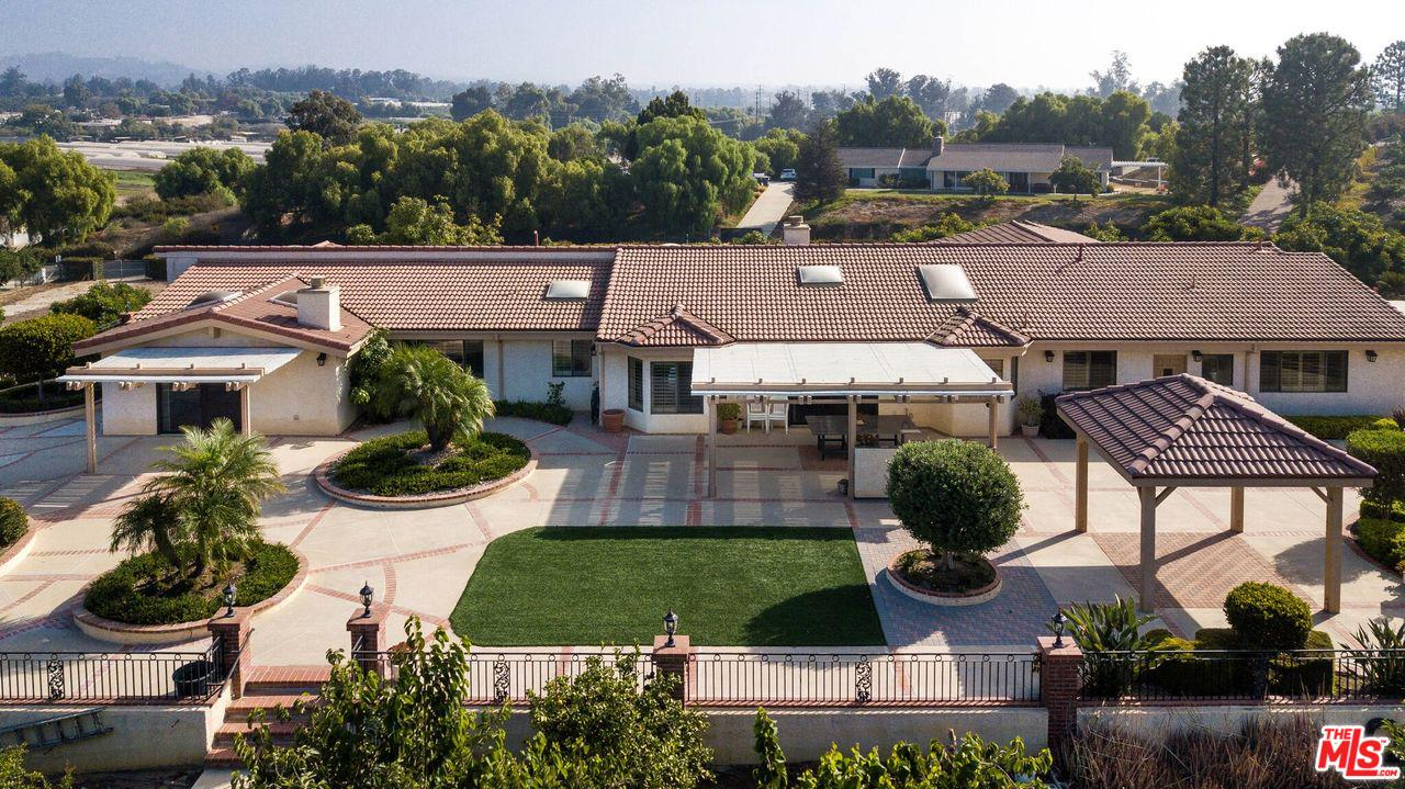 Magnificant custom gated estate on 2.50 acres with  avacado orchard and unbelievable panoramic views! Located in the Somis Hills. Lavish grounds including custom planters, 2 gazebos, 2 patios, built in BBQ, brick pathways and basketball court. Enter  into a  foyer with granite flooring,11 skylights, 3 fireplaces, grand master suite  with fireplace, lavish master bath, vanity and walk in closet. Gorgeous gourmet kitchen with granite counter tops, beautiful wood cabinets and breakfast  area. Large family room with wet bar and fireplace. Living room with plantation shutters and beautiful fireplace and formal dining area. Five bedrooms  which includes a private maid or in law suite with own entrance. Also  a utility room/office and a workshop! Ionized water system , security system and intercom.Newer 5 zone HVAC . Enjoy breakfast outdoors with fruit from your fruit  and avacado trees. Possible income .