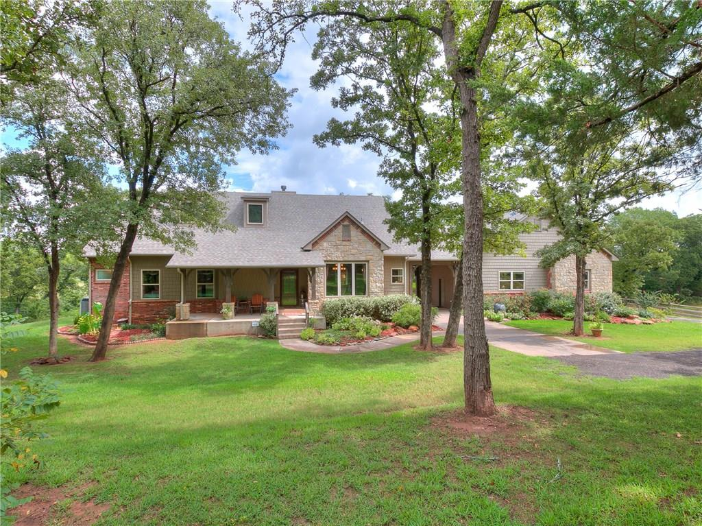 STUNNING private & wooded retreat with gated entrance, minutes from I-35. This Custom built home is energy efficient with 5 BEDROOMS (or 4 bed & a study), a walkout basement, 2 fireplaces, bonus room, walk-in safe room and SO MUCH MORE! Main level has master bedroom & study, 3 bedrooms are on walkout basement level.  The inviting sunroom is surrounded with windows overlooking fantastic views of the property and a chef's dream kitchen with electric AND induction stove and double ovens! Drive through Porte cochere and 3 car garage with rear entry. Includes:  New 80 gal hot water tank, indoor safe room, pantry, sub zero fridge, pot rack, underground sprinkler system,  All new A/C in 2016/2017, some new windows, steam shower and water softener to entire house. Kids will enjoy exploring the creek & fishing in the pond! NO HOA to follow here. Back of property could be used for horse pasture. Enjoy serenity and this beautiful slice of heaven! High Speed Internet available!