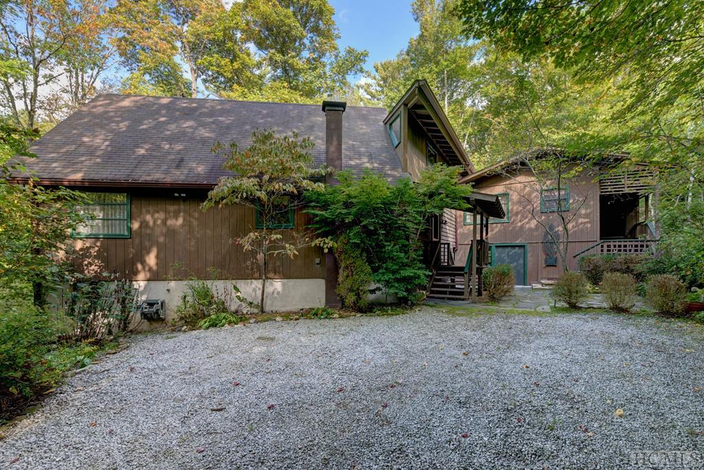 "A Piece of Heaven, Waterfront, Creatively Designed 4 Bedroom Cottage, in-town Highlands.  A large front yard slopes to your private canoe dock on Big Creek, you can paddle to Lake Sequoyah with ease.  Adjoins Highlands-Cashiers Land Trust Property, so your vista and front yard is immense replete with zip lines, fire pit, and solar-lighting along the stone walkways. Storage and access areas for all your toys...canoe, kayak, Harley Davidson, or lawn equipment.  A rustic home that exudes ""the Highlands feel"" in every way, and furnished.  This property is part ""On Golden Pond"" and part ""Swiss Family Robinson""...bring a toothbrush, fly rod, and your hiking boots!  Highlands, NC.  where you live more outside than you do inside, and this property is the quintessential example.  Meanwhile, head to town (5 min) for the convenience of music, shopping, dining, events, and culture that rivals the best resort towns in America, and beyond!"