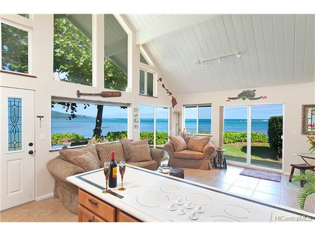 Extraordinary windward-north shore oceanfront home extensively renovated. Ocean, coastline, mountain views from every room, including the 2 bedrooms on the first floor, and large oversized loft upstairs; 1.2 baths on the first floor, with plumbing alreadyset-up to put another bath upstairs. Nestled on Kahana Bay Reef, this is aunique community of8 individual homes each with large lanais; HOAprovides owners more free time to enjoy onsite Hawaiian lifestyle, tropical landscape and swimming pool; fishing, surfing, snorkeling, kayaking and more; plus all the white sandy beach/parks stretching the length of Kaaawa Beach to Kualoa Park. Relax while watchingbeautifulsunrises andmoonrises reflect off the ocean waters. Owner willing to sell furnished.