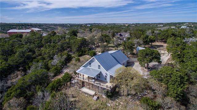 Unique opportunity to own 14 acres in popular hilltop community with panoramic view of the hill country! Property has two separate structures - Main house has 3 beds, 2 1/2 baths, large bonus room upstairs, new paint, and new flooring; second house is well-maintained with long-term tenants - perfect for home owners and investors alike! Cul-de-sac lot on quiet street, sought-after Apple Springs neighborhood with acreage and custom homes. This is truly a one-of-a kind property, do not miss this opportunity!
