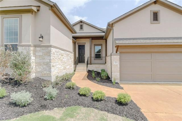 "Beautiful upgrades are abundant in this one-story, 3-bedroom, 2.5-bathroom home in the Rough Hollow community of Lakeway, Texas. Come live the ""Rough Life"" in a community featuring 4 gorgeous pools and access to Lake Travis, among other benefits. An 8-foot front door and wide-plank, hardwood floors lead you past the modern style entrance and into the spacious family room that's full of natural light. The gorgeous kitchen features stainless steel appliances, granite countertops, and a breakfast area nearby"
