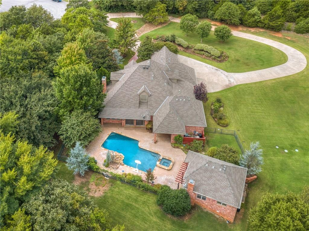 Custom ONE owner home on 2.5 ACRES and in a cul-de-sac in Edmond, OK with a pool & cabana! This home is absolutely stunning with tons of quality features and recent updates. 4,300+ sq. ft. 3 bedrooms, 3 full & 2 half bathrooms, huge 2nd living/game room (possible 4th bedroom) with 1/2 bath, executive study, open kitchen/dining, formal dining, huge covered patio, swimming pool with waterfall, cabana, & 1 car garage with tool shed. Cabana has HVAC, a full outdoor kitchen, covered patio, fireplace, and stunning view. All of this tucked away on 2.5 acres in a cul-de-sac with almost complete privacy. Located minutes from downtown Edmond, shopping, dining, highway access, and more. You won't be disappointed.