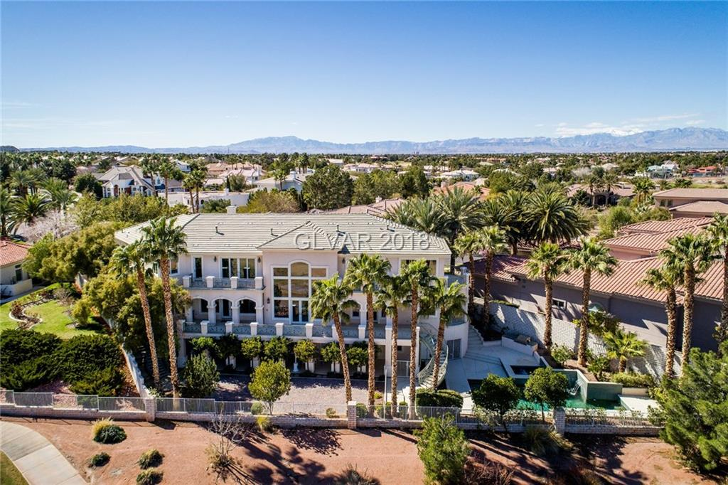 Luxury and Quality!. This magnificent estate boasts over 10400+sq.ft.,140 Andersoen windows,solid core 8ft. doors,10 inch concrete-filled exterior walls, built-ins custom cabinets throughout,7bd.rms,2 master suites,9 baths, 3family rms,state of the art media room, 2studies, views city, mountains&golf course.Its kitchen features dual commercial grade hood, stainless steal appliances,granite counters.Complete walk-out basement with kitchen,& bd. rm