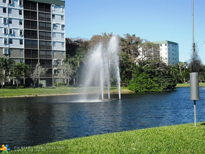 Large corner condo with beautiful water and pool views. A true 3 bedroom, not a convertible. Updated kitchen and baths, large living/dining area, beautifully maintained. Great location close to major highways, shopping, banking, dining, and only 5 miles to Pompano's beautiful beach and new restaurants. Water views from all rooms, large balcony for outdoor relaxing/dining. Cypress Bend has a variety of amenities for all tastes from fitness to playground and everything in betwen. NO DOGS PER CONDO ASSOC.