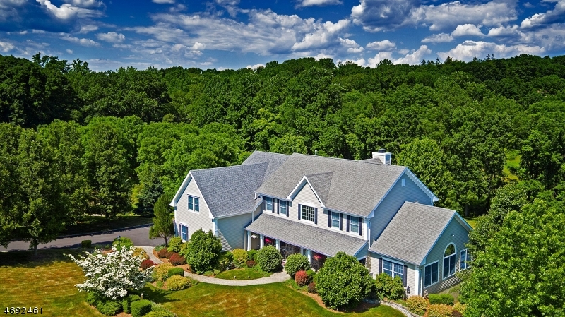 Privately situated at the end of a cul de sac on three lushly-landscaped acres, a Tewksbury Township Colonial enjoys a prime location. Views of the manicured acreage are enjoyed from every room. An ex