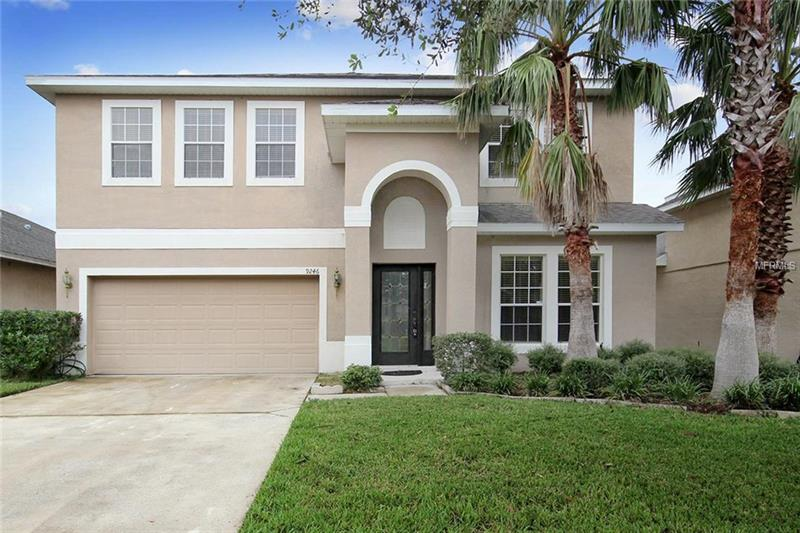 **Sought after DR. PHILLIPS area....just 20 minutes from the parks!  Arlington Bay community is convenient to everything Orlando has to offer plus zone for top-rated schools.  **Beautiful 4 bedroom/ 3.5 bath home with a POND VIEW**LOW HOA**BONUS ROOM UP**Tile throughout the downstairs living area, abundant windows for natural light, neutral color palette, architectural details and a private screened lanai area.  Centrally located kitchen opens to the dining area and family room with sliders to the screened lanai.  Spacious upstairs master bedroom with bath that boasts a walk-in shower, corner garden tub, and dual sinks.  3Rd & 4th bedrooms share a Jack n Jill bath.  Versatile large bonus room up would make a great 2nd family/game room or office. 