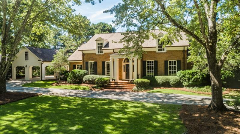 Truly beautiful home in popular Rivermeade on over an acre. Breathtaking lake view beckons from the front door through the elegant 2-story foyer and formal dining room. French doors to a walk out patio w/spa, firepit, expansive rear yard overlooking lake. Hickory floors throughout main level were remnants from the Cloister. Library w/knotty pine paneling and formal salon. Chef's kitchen open to family room and a second vaulted great room. Master on Main features separate his and hers bathrooms. Bonus office over carport. Near top rated schools.