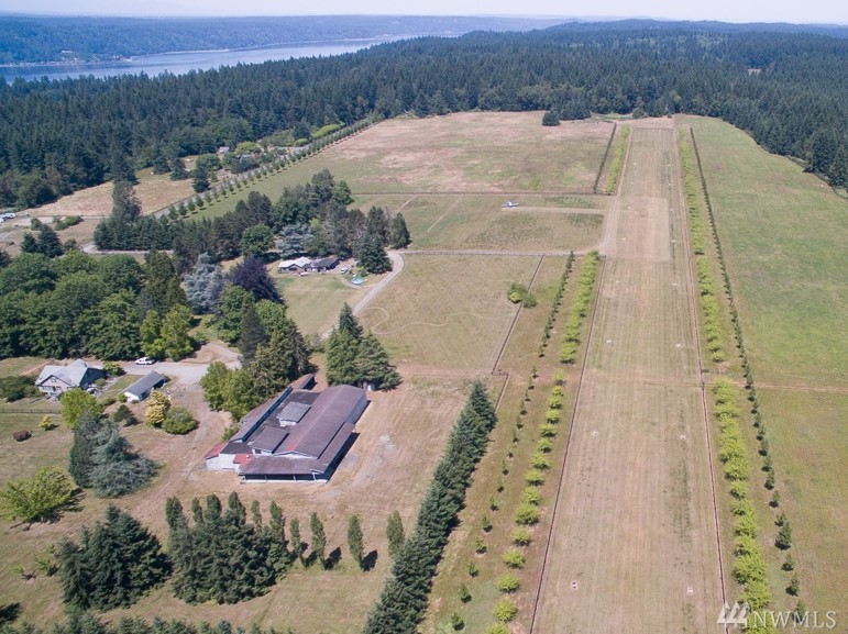 Approximately 227 acres on 20 separate tax parcels ranging from RA-5, A-10 to RA-10 zoning.  There are several structures and homes on the property, but the value is in the land.  The acreage includes about 5 miles of horse back trails and a 2200 foot long private airplane landing strip; as well as beautiful pastures and orchards.  The property could make a great private or public agricultural center for the Community and area.  Adjacent additional property potentially available for sale also.