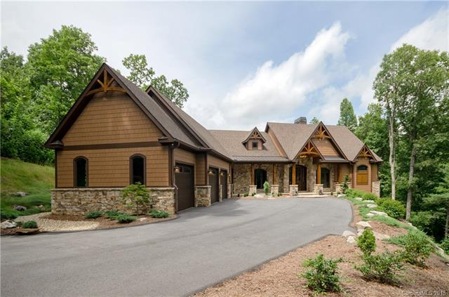 Incredible attention to every detail in this Kenmure mountain estate home. The main level offers a great room with large windows to take in the Long Range Unobstructed Year Round VIEW, maple floors, soaring rock fireplace and wood beams in the vaulted ceiling. The main kitchen includes a 16 ft island with leathered granite and chiseled edges, copper sink, Subzero and Wolf appliances, granite back splashes and flag stone floors. Just steps from the kitchen is the screened porch with EZY Breeze window/screen system for year round use. The screened porch also has a rock fireplace, natural gas grill with vent fan, and flag stone floors. The main level also includes an office with built-in shelving and wainscoting. Master bedroom has motorized window coverings, maple floors, master bath with granite walled shower,pebbled interior and two granite vanities and large walk-in closet. Lower level has two guest bedrooms with ensuite bathrooms,family room with rock FP and  storage.