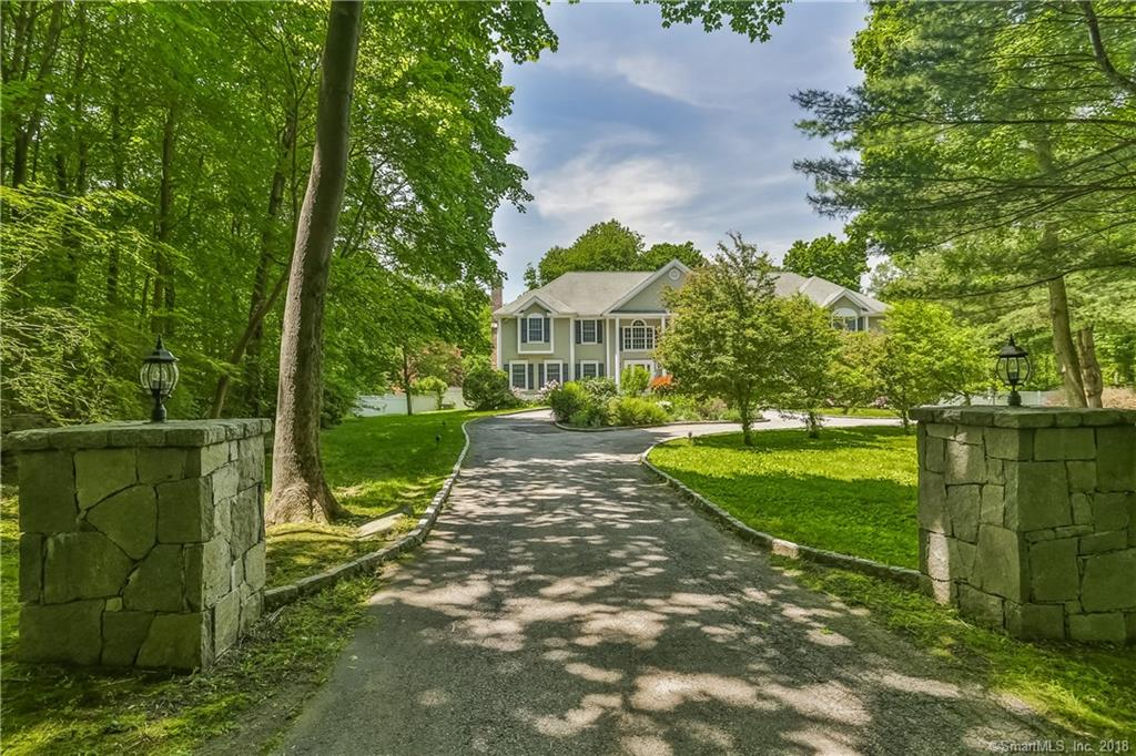 BEAUTIFUL SOUTH WILTON home with FOUR CAR GARAGE, only 4 minutes to the Rt 7 Connector and major commuting roads. This 1995 built Colonial is set on VERY private, completely level, park-like, property.  The yard is filled with towering trees, perennial gardens, and lots of space for football games! Terrific in-ground heated Gunite pool with whirlpool spa is such a wonderful addition to the outdoor entertaining fun .  Step into the double story foyer and you'll see the impressive butterfly staircase and spacious formal rooms. The layout of this home is spacious and wonderful for entertaining a crowd. The kitchen is delightful with newer stainless appliances, granite counters & back splash, wide plank hard wood floors, open to the breakfast area and easy access out onto a terrific over sized deck. Fabulous family room with field stone fireplace directly off the kitchen, private library/office on the first floor and back staircase. 2nd floor offers very nice size bedrooms all with en-suite baths. Romantic master bedroom suite complete with fireplace, enormous master bathroom/walk-in custom closet. Bonus room over garage is quite large and perfect if you need an in-law or Live -in private area/bathroom.  Extras: Propane house generator,  high end audio/speaker system, security system.  Located around the corner from K-2 Elementary school and 5 minute drive to all other AWARD WINNING Wilton schools, the Village Center shops and metro north train.  A wonderful place to call HOME!