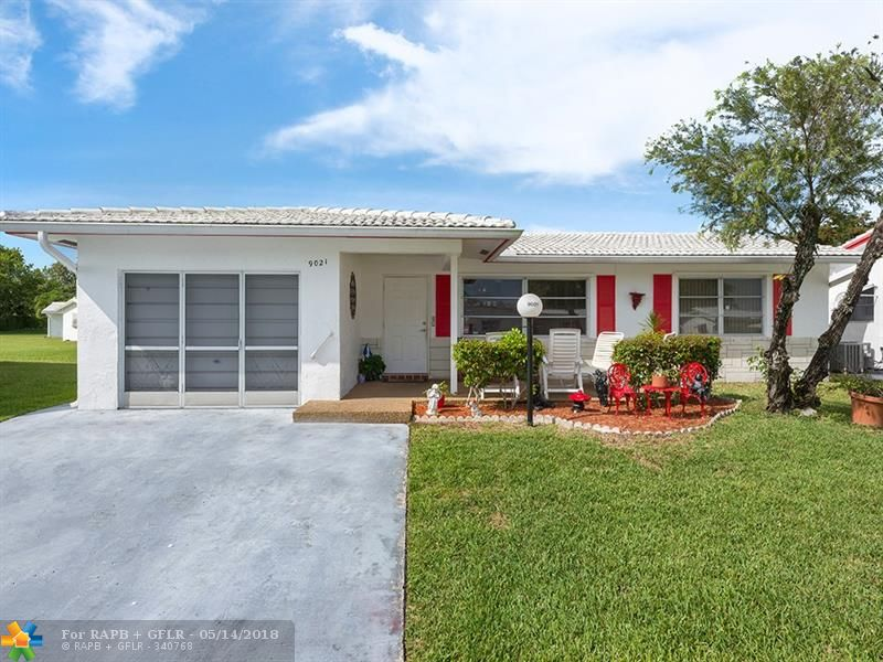 Updated 3 bed/2 bath in desirable Lauderdale West Community! Light & Bright featuring tile throughout, beautiful crown molding, neutral paint, upgraded eat-in kitchen w/granite counter tops.  Additional 3rd bedroom complete with permits.  Ample closet space, plantation shutters and hurricane panels.  Spacious garage that doubles as a utility/laundry room.  One occupant MUST be 55 or over; no children under 18! Centrally located - close to major roads, shopping, dining and schools. MOVE IN READY! MUST SEE!