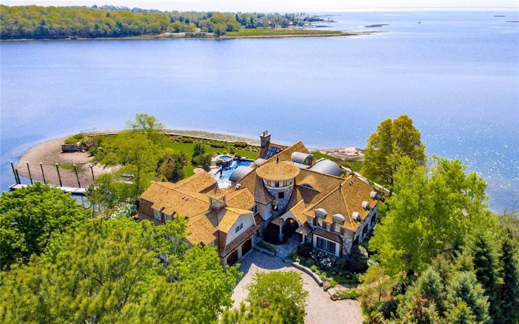 With over 700 feet of remarkable shoreline, Paradise Point is a rare opportunity to come home to your very own private peninsula with 180 degree views of the magnificent Long Island Sound.  This peaceful oasis offers the ultimate 'vacation where you live' experience.  Paddle board right off your deep water dock or spend the day hosting friends on the meticulously landscaped patio which centers around an organic pool, full service outdoor kitchen and your private beach.