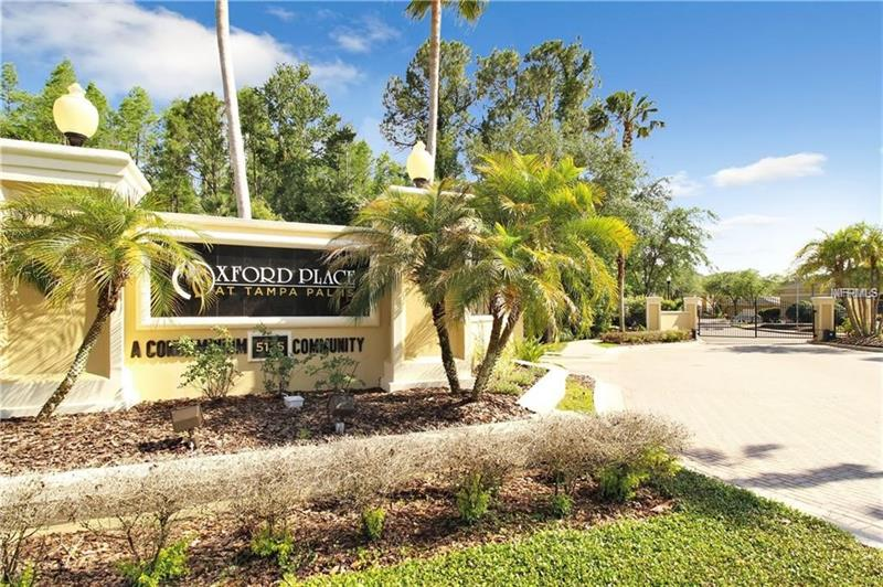 EXCEPTIONAL LOCATION IN A Florida Resort Style Living.  This exclusive gated Tampa Palms Condominium Community comes with 2 bedrooms and 2 baths, hardwood floors throughout, updated stainless steel appliances and a newer front load washer/dryer.  The garage (84)is located directly under the unit allowing for easy indoor access. Enjoy the well maintained property with lots of amenities! Spectacular pool, volleyball court, BBQ, playground, fitness, social gathering room, Sauna! Doggie & car wash area for added luxury! Excellent onsite management for a no worry atmosphere.  Truly one of kind easy living in New Tampa.