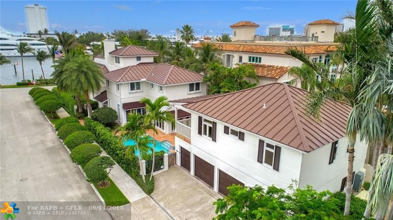 Live on prestigious Idlewyld Drive in Fort Lauderdale! Amazing views of the Intracoastal Waterway with a private dock directly on the Intracoastal with ocean access and no fixed bridges. This 5 bedroom, 5.5 bath home has a bright chef's kitchen opening up to the living and dining rooms, expansive master bedroom and newly remodeled master bathroom. The detached Guest House consists of 2 bd/2 baths and a 3.5 car garage. Enjoy east ocean breezes while watching the constant parade of Yachts.