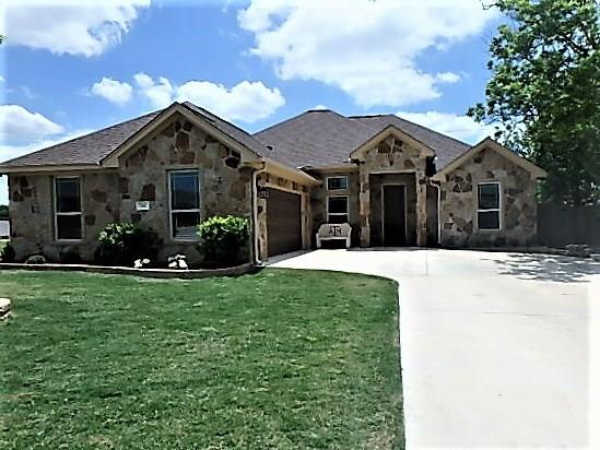 Beautiful 3 bedroom, 2 bath custom home in Jarrell, Texas.  Nestled on a large corner lot, this home has plenty to offer.  Granite counters, open floor plan, stainless appliances, large walk-in closet, double vanity in owners suite, and a bonus study are just a few of the many amenities that this property has to offer.