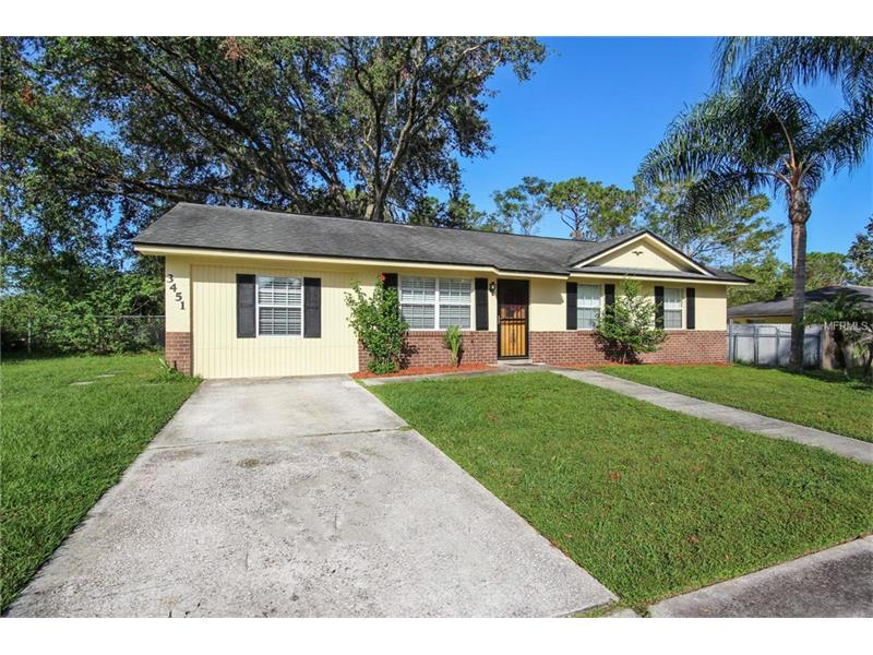 Whether you're a first time home buyer, looking to downsize or investor,  you'll appreciate this spacious lot, **NO HOA** and close proximity to everything you need: grocery, gas dining and more within a mile radius. Just minutes to UCF, Orlando International Airport and downtown Orlando.  **Updates abound-NEW LIGHT GREY WOOD PLANK PORCELAIN TILE throughout, NEW PAINT, 5 INCH MOLDING throughout, NEW BLINDS throughout, NEWER 6 PANEL DOORS, NEWER AC UNIT, NEW STAINLESS STEEL RANGE AND MICROWAVE and NEWER ATTIC INSULATION. ** The newly open great room plan unifies the living space so that you can interact with family or guests easily. The fully enclosed carport is complete with recessed lighting and AC and makes a great space for an office/playroom/flex space. Catch up on your laundry in a snap with your interior laundry room and a newer shelving unit to store all your items.  The large backyard will quickly become your favorite place to sip your morning coffee, utilize your shed for additional storage or enjoy time around your newer brick fire pit.  The perfect size home/yard for easy maintenance is waiting!