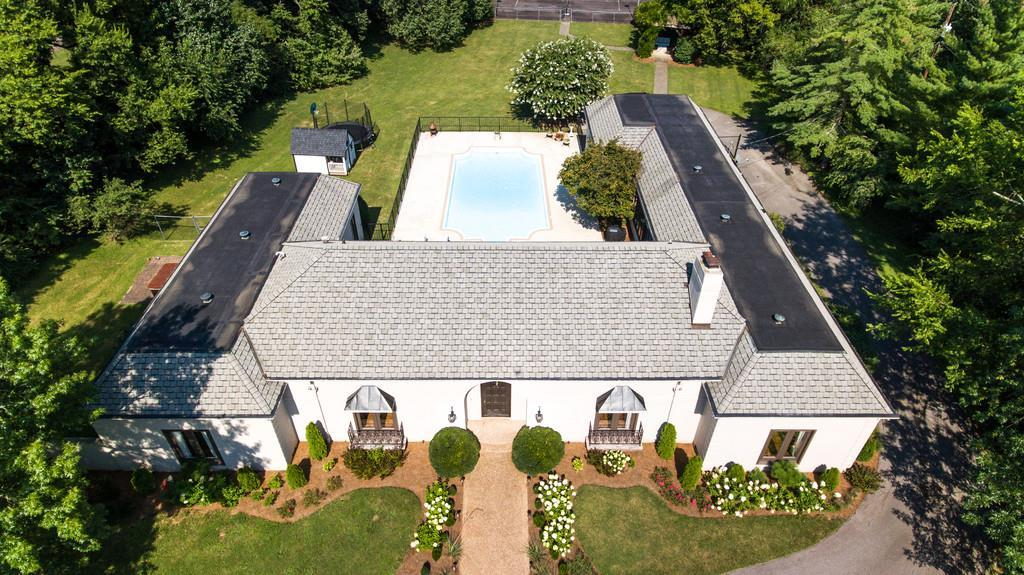 Classic Hacienda situated on 2 very private acres in Forest Hills. Stunning kitchen remodel, salt water pool, lighted tennis court & gazebo, all 1 level, expansion possibilities. New HVAC 2013 . Rare opportunity for in-town privacy & resort-style living!