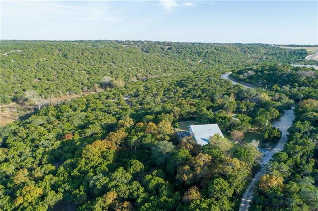 Listing includes 14.3 acres located at 13201, 13209 & 13233 Vista Rock Dr-Commercial, Residential & Farm & Ranch options-Private road w views of the Hill Country stretching the horizon,retaining it's natural splendor w electricity,well water,septic already in place-Creek running through property-2 houses & 2 manufactured houses on prop.-Main house (light blue) is described in listing-Amazing location off 1431,quick access to retail and businesses-Call agent to show house and land.