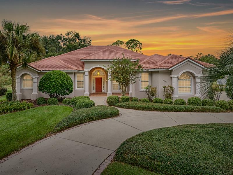 Welcome to this gracious home located in the prestigious community of Harbor Hills Country Club.  Located on the desirable, mature oak tree lined street of Spinnaker Loop, this custom built home has so much to offer.  The welcoming circular drive leads you into the grand entry with volume tray ceilings and custom crown molding.  The open floor plan greets you with spaciousness and abundance of natural lighting.  The Kitchen, open to the family room and dinette, share spectacular views of the golf course!  The split floor plan is highlighted by an elegant master suite detailing an airy master bedroom, roomy master bath and expanded his/her walk-in closets.  French doors lead out to the distinctive feature of this home, the expanded lanai.  Spend your afternoon relaxing, reading a book, listening to the birds while taking in the amazing views situated on the 17th hole of the golf course.  This home has been impeccably maintained with a duel AC system installed 2015, exterior paint in 2016 and new refrigerator in 2016. This family, gated community is just minutes from The Villages where you can enjoy restaurants, shopping and entertainment!