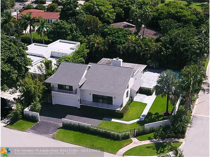 Attention beach & boating enthusiasts this fun & sun-filled residence is across from private surf club & overlooks the Marina with fabulous views! Located in one of City's most desirable gated communities.Over-sized corner property allows additional privacy & sunny South exposure to pool & large lawned play area. Renovated in 2017:impact glass, porcelain tile flooring, new kitchen appliances & bathroom vanities. Abundant windows & large rooms create a light & bright retreat. Marina subject to availability